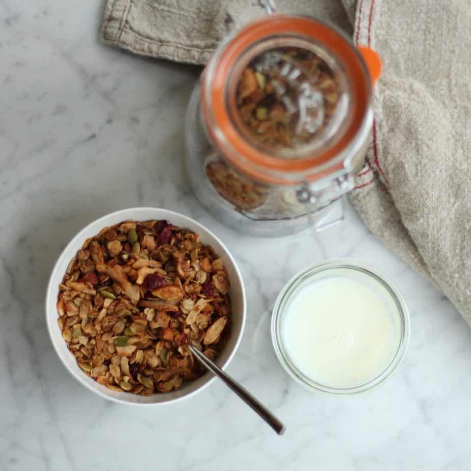 Homemade Granola with Milk on Marble Kitchen Countertop