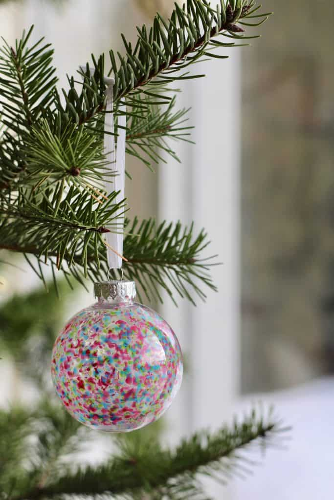 Brightly Coloured Cheerful Melted Crayon Ornament on Christmas Tree