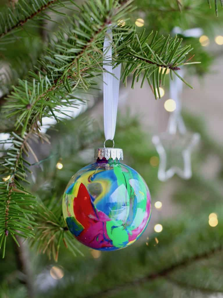 Colorful Kids Round Ball Tree Ornament on Christmas Tree