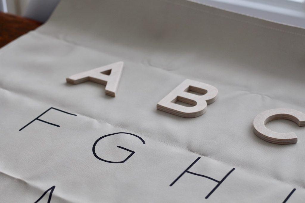 DIY wood letters on alphabet gathre mat