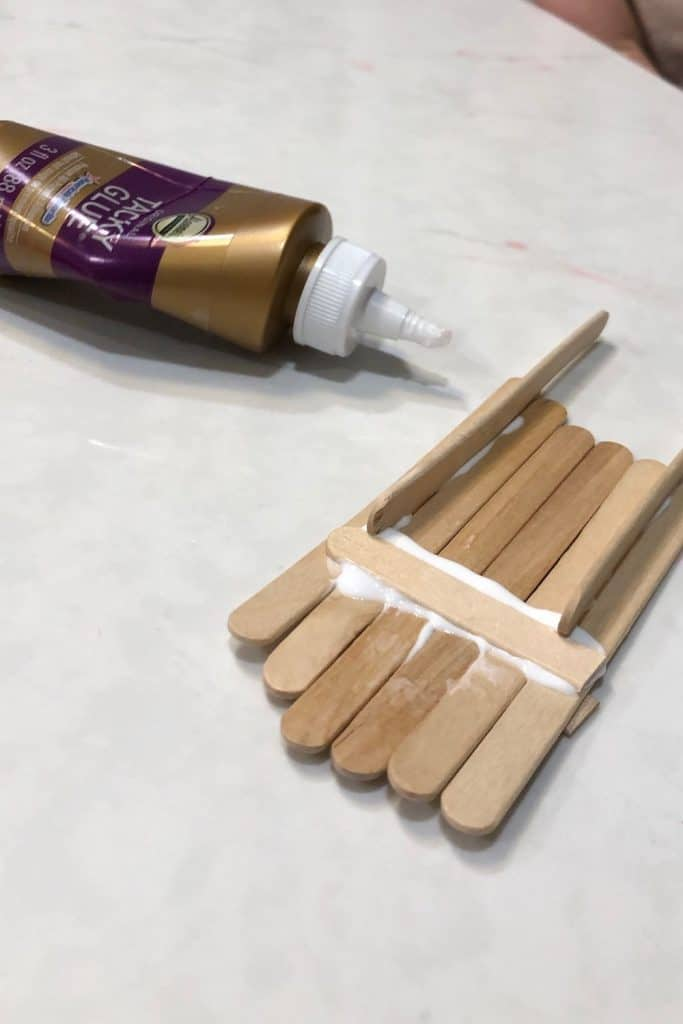 Glue popsicle stick sled together