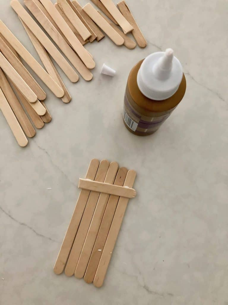 Glue together popsicle sticks - preschool winter craft - sled toboggan