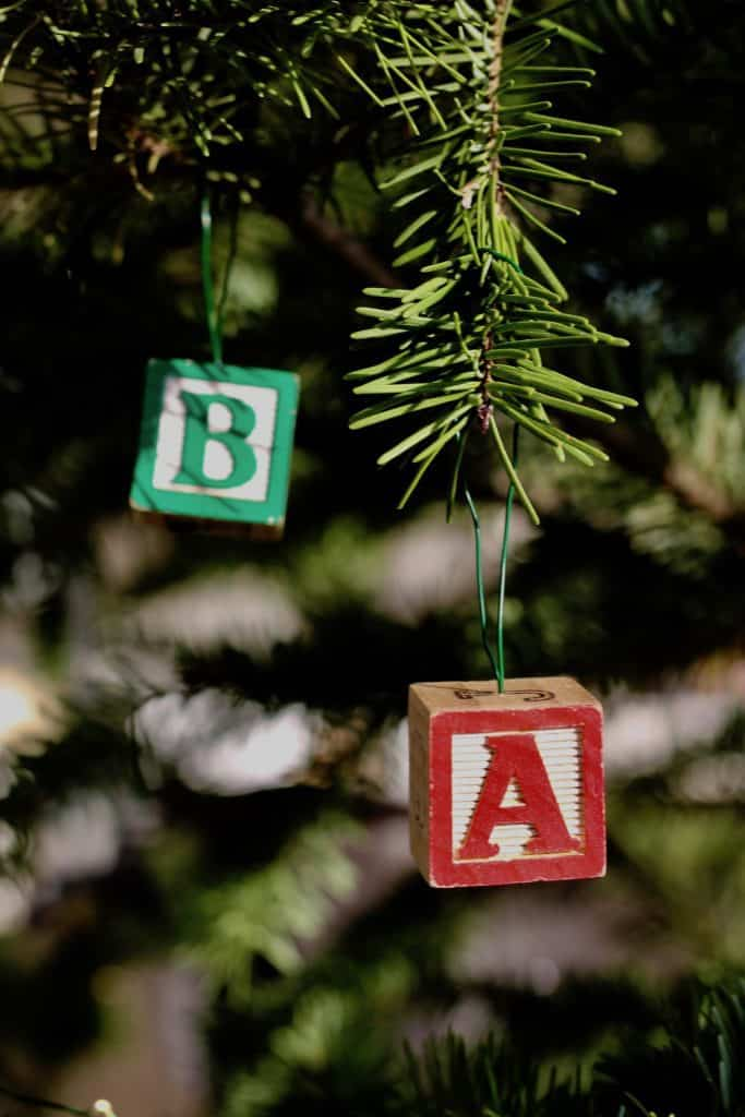 Kids wooden block letter alphabet ornaments on Christmas tree