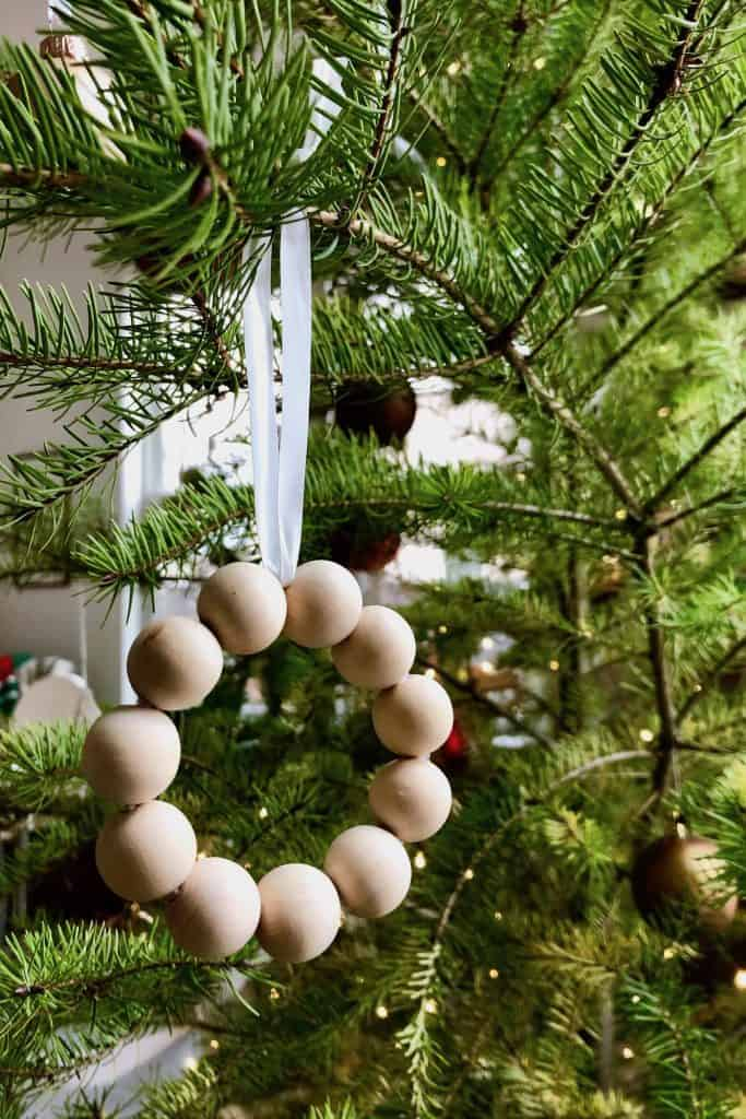 Preschoolers Christmas Ornament of Wooden Beads Hanging on the Tree