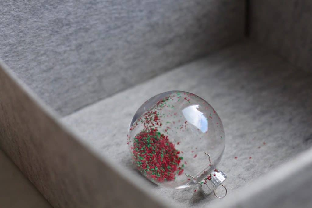 ornament filled with crayon shavings to be melted