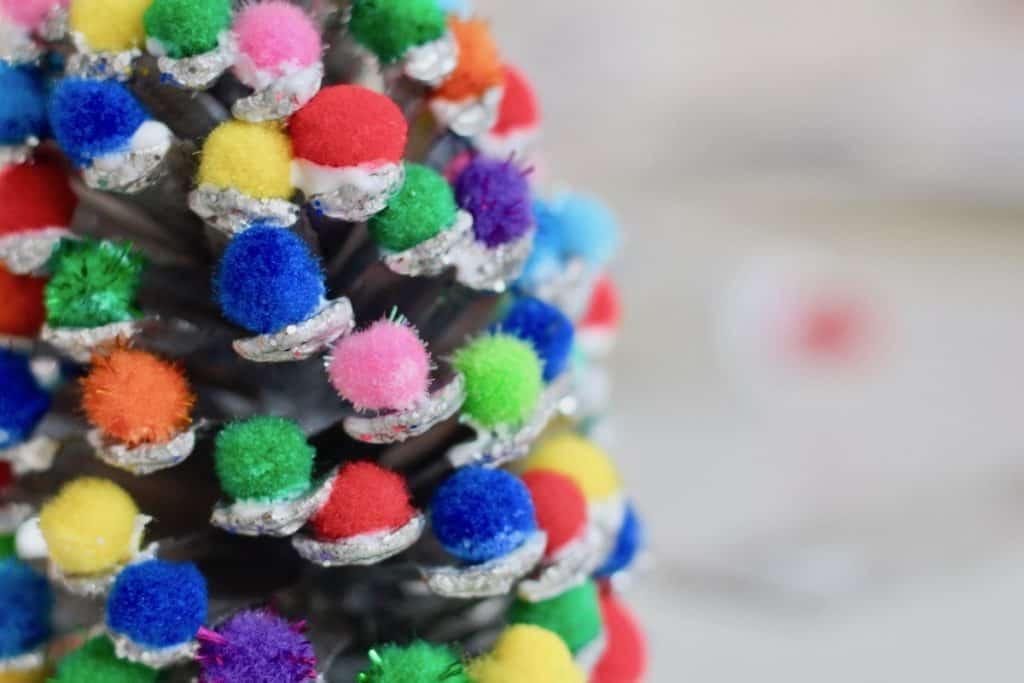 Glue a pom pom onto each scale of the pinecone