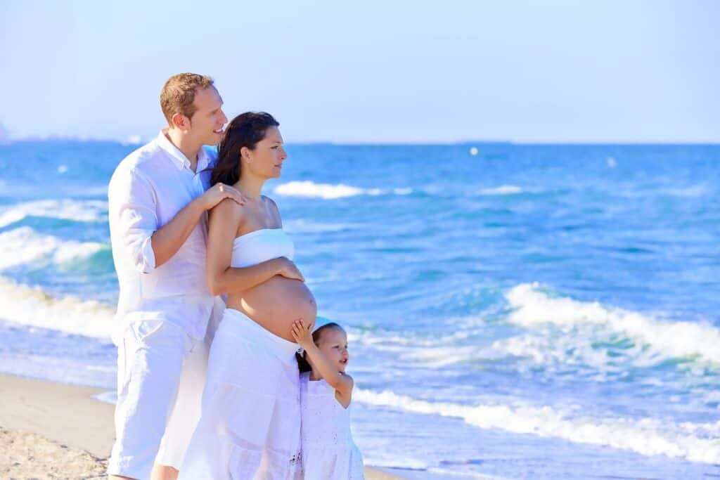 beach pregnancy photos dressed in white - whole family
