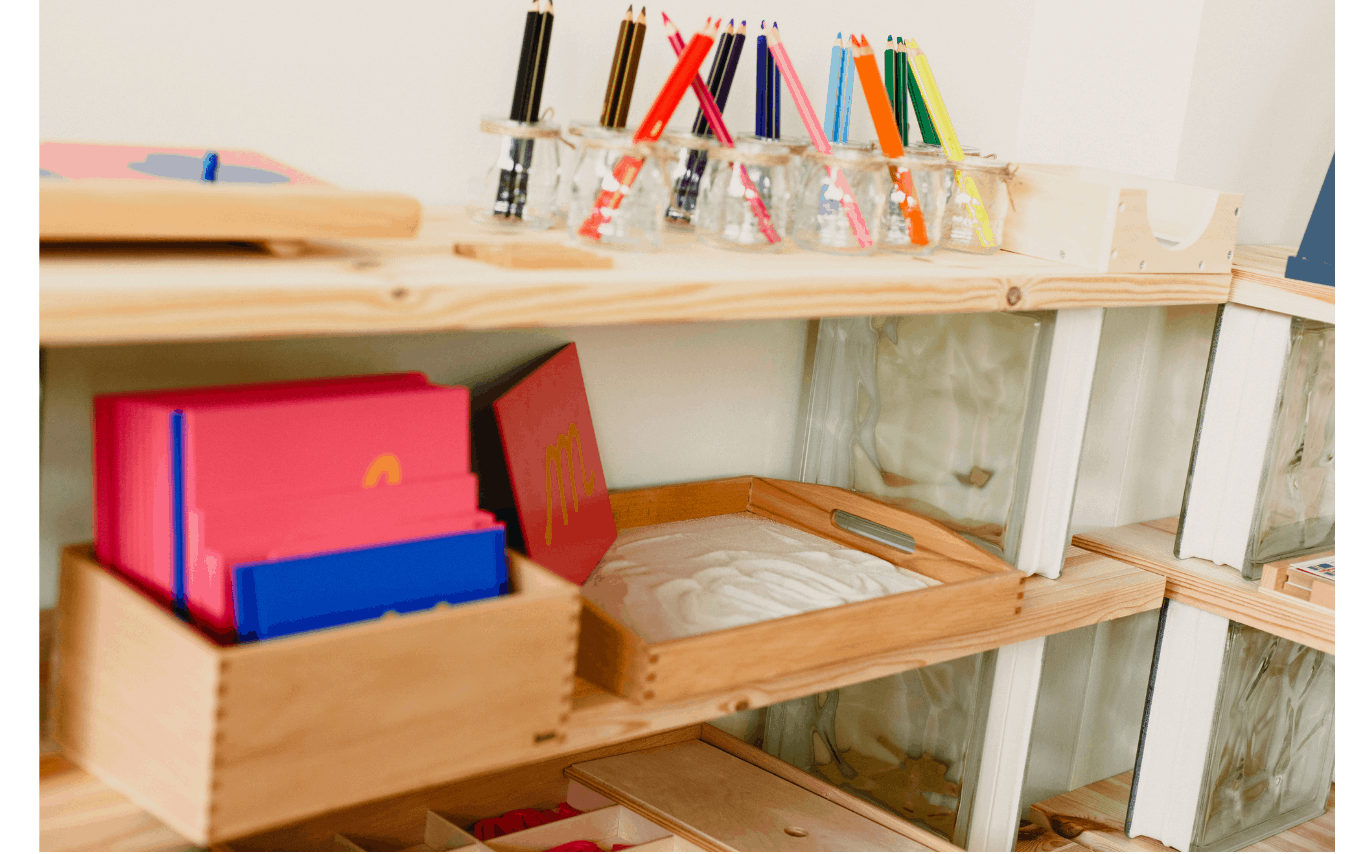 Montessori playroom shelves with trays and baskets