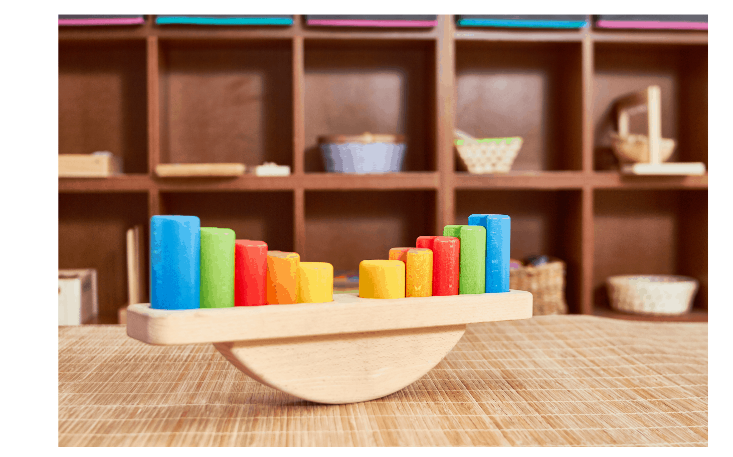 Montessori educational toys on clean wooden shelves